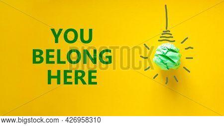 You Belong Here Symbol. Green Shining Light Bulb Icon. Words You Belong Here. Beautiful Yellow Backg