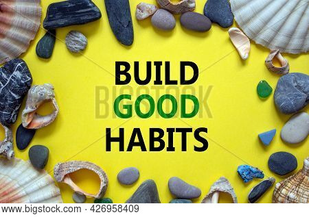 Build Good Habits Symbol. Words 'build Good Habits' On A Beautiful Yellow Background. Sea Stones And