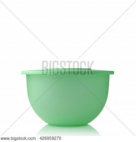 Plastic Container. Plastic Bowl Of Green Color Isolated On White Background. Food Container. Pronoun
