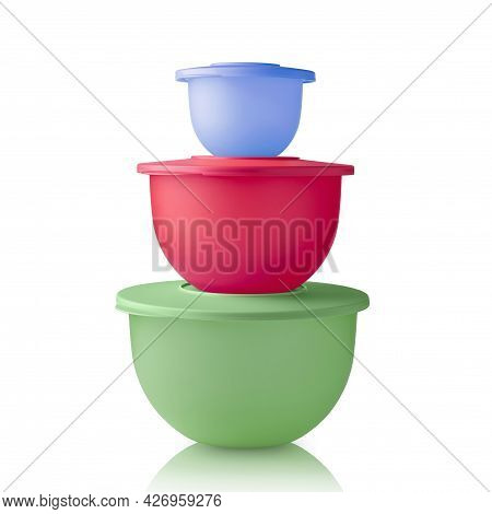 Plastic Container Stack. Plastic Bowls Green, Red And Blue Are Isolated On A White Background. Food