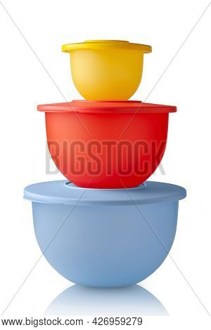 Plastic Containers Tupperware. Stack Of Colorful Plastic Bowls Isolated On White Background. Food Co