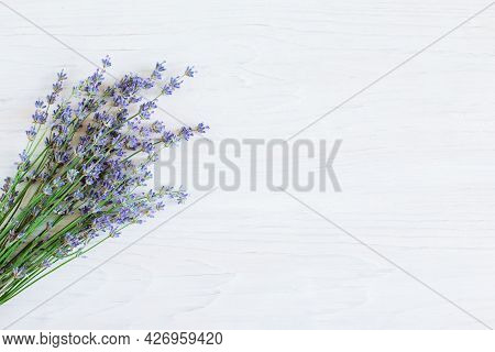 Beautiful Lavender Flowers On A White Wooden Background. Flat Lay. Place For Text.