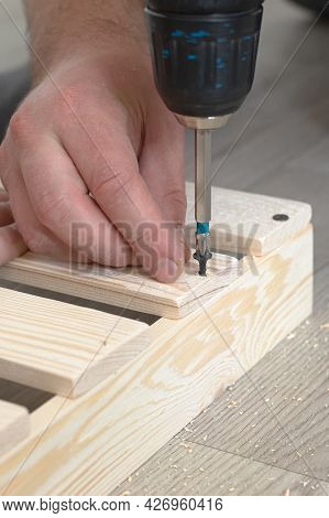 Wooden Slats And Working Tools. Carpentry Work. The Self-tapping Screw Is Screwed Into The Wooden Pl