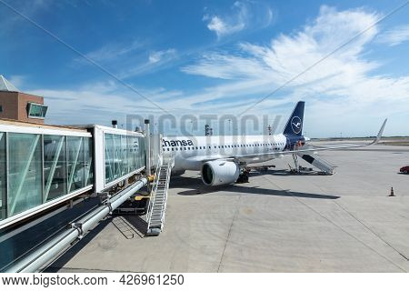 Venice, Italy - July 1, 2021: Lufthansa Airbus At The Gate With Tourists At The Venice Airport Marco