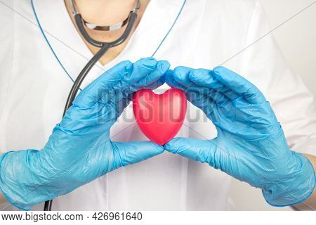 Medicine And Healthcare Concept. Heart In The Hands Of A Doctor. Cardiology And Heart Disease Concep