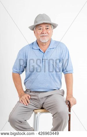 Portrait Asian senior man , old man , feel happy good health wearing a hat and holding a walking sti