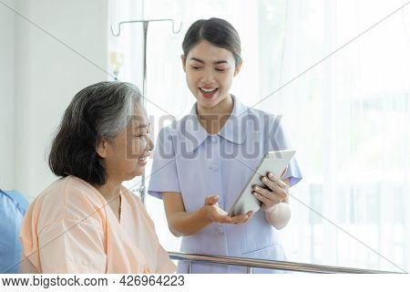 Nurse Inform Health Examination Results To Encourage Senior Elderly Woman Patients In The Hospital-