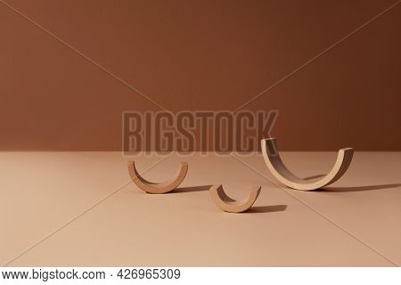Three Wooden Arc Constructor Abstract Minimal Product Promotion Pedestal With Shadow On Brown And Be