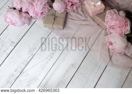 Festive Background, Layout Of Craft Boxes And Flowers On A Wooden Table, Gift Wrapping, Copy Space