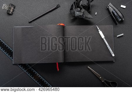 Opened Black Notebook. Opened Journal With No Entries. Place To Write Text. View From Above.