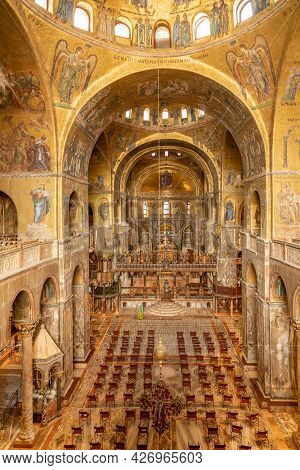 Venice, Italy - July 1, 2021: Golden Wall Mosaic Inside St Mark`s Basilica Or San Marco In Venice. I