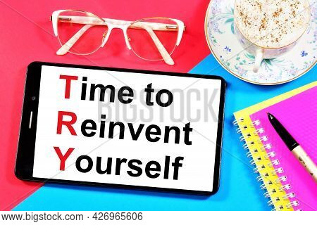 Time To Reinvent Yourself. The Inscription Of The Motivational Message On The Smartphone Screen. Unl