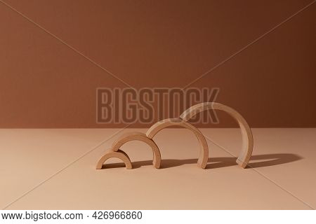 Four Wooden Arc Constructor Abstract Minimal Product Promotion Pedestal With Shadow On Brown And Bei