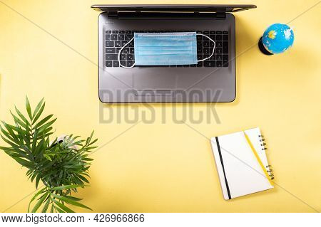 Laptop And Medical Mask. Choosing A Country For Tourism. Laptop And Notepad. Ban On Tourism. Top Vie