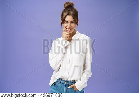 Sensual And Flirty Self-assured Attractive Woman In Stylish White Blouse With Good Self-esteem Holdi