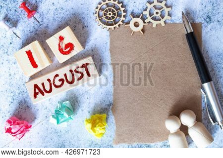 Calendar With Trendy Blue Text And Numbers For August 16 And A Gift In A Box.