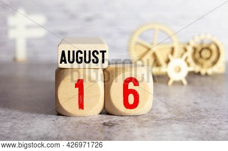 August 16. Date Of August Month. Number Cube With A Flower And Sign Wood On Diamond Wood Table For T