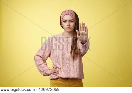 Stop It. Serious-looking Confident Focused Young Cute Girl Extending Arm Hold, Tresspass Gesture, Fr