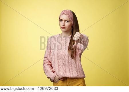 Not Cool. Frustrated Displeased And Disagree Cute Young Woman Wearing Knitted Sweater Frowning Showi