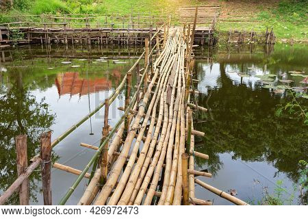 Bamboo Bridge On An Irrigation Canal In The Countryside,  Wooden Bamboo