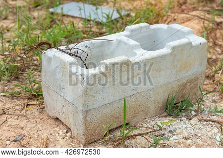 Old Cinder Blocks Of Gray Concrete Are Neatly Stacked In A Pile, Slender Rows Of Bricks, Material Fo