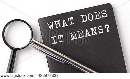 What Does It Means - Business Concept, Magnifier With White Text Message On Black Notebook