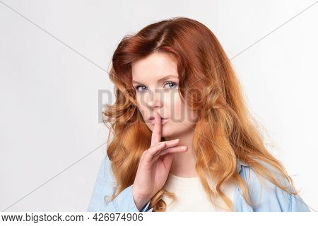 Portrait Of Young Business Woman Keeping Finger On Her Lips And Asking To Keep Quiet, Isolated Over