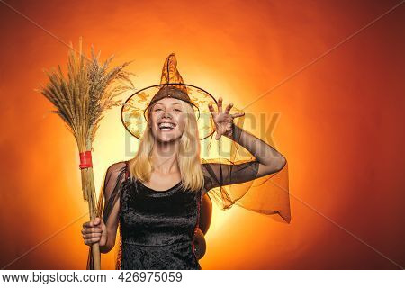 Sexy Woman On Orange Background. Background Decorated For Halloween. Happy Halloween. Halloween Part