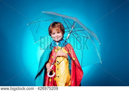 Child With Color Umbrella On Blue Sky. Autumn Copy Spaceautumn Trend And Autumn Vogue. Ready For Tex