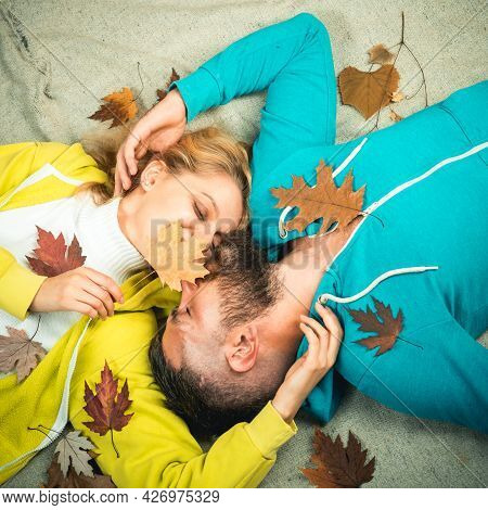 Sensual Couple Kiss On Autumn Background. Colorful Autumn And Dry Leaf. Ready For Text. Happy Couple