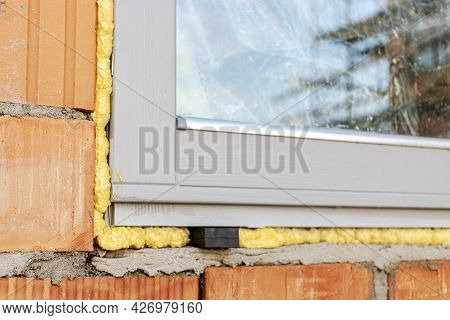Installation Of A Window In A Brick Building. Industrial Engineering. Darkening And Installation Of