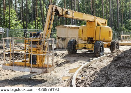 Man's Work Is At A Height. Self-propelled Construction Mechanism For Lifting Workers To A Height On