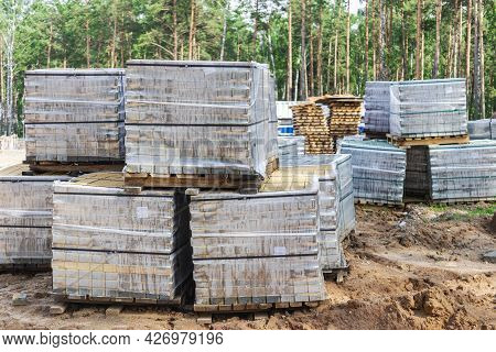 Storage Of Paving Slabs On Pallets At The Construction Site. Ready-to-install Concrete Paving Slabs.