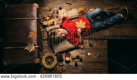 Cute Little Child Boy Are Getting Ready For Autumn. The Biggest Discounts For All Autumn Clothes For