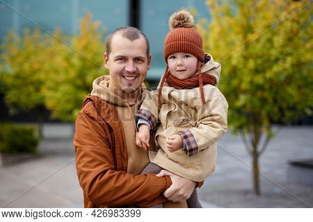 Family, Fatherhood, Love And Happiness Concept - Portrait Of Smiling Father And His Little Daughter