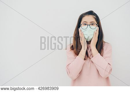 Portrait Of Worrying Asian Woman Wearing A Mask To Protect Against Infectious Diseases From Virus Or