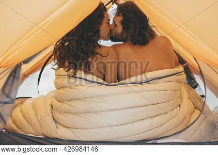 Naked Couple On The Beach In A Tent