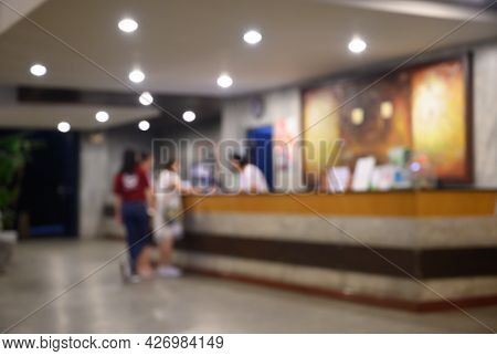 Blurred Image Of Hotel Lobby When Curtomer Visit For Check-in At Reception Desk. Hotel Lobby Is One