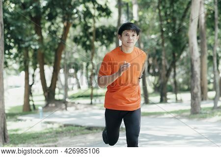 Athletic Young Man Running In The Morning.