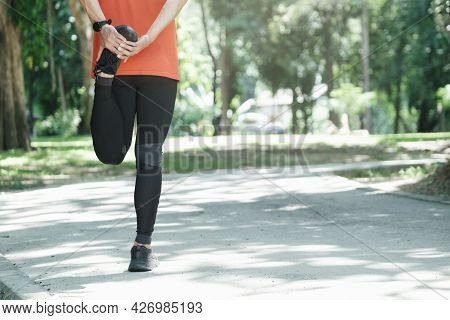 Young Man Runner Stretching Legs. Active And Healthy Lifestyle Concept.