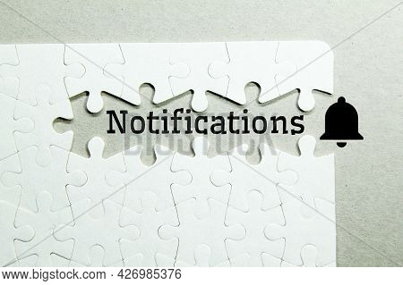 White Puzzle With The Word Notification. Notification Icon