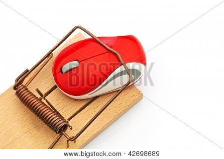 the mouse of a computer in a mousetrap. symbolic photo for the event costs, debt trap and roaming charges.