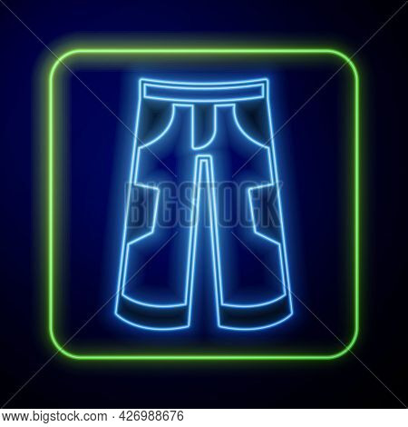 Glowing Neon Pants Icon Isolated On Blue Background. Trousers Sign. Vector