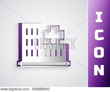 Paper Cut Medical Hospital Building With Cross Icon Isolated On Grey Background. Medical Center. Hea