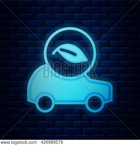 Glowing Neon Eco Car Concept Drive With Leaf Icon Isolated On Brick Wall Background. Green Energy Ca
