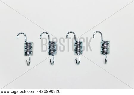 Four Short Metal Springs For Repairing The Brakes Of The Machine. Set Of Spare Parts For Car Brake R
