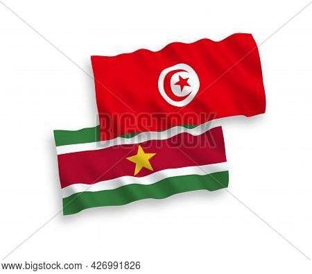 National Fabric Wave Flags Of Republic Of Suriname And Republic Of Tunisia Isolated On White Backgro