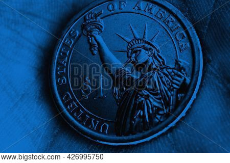 Us Coin Lies On The Palm. 1 One Dollar Coin Close-up. Dark Blue Tinted Wallpaper. Economic, Financia