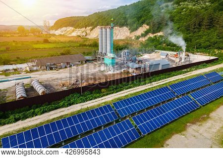 Aerial View Of Electrical Power Plant With Rows Of Solar Photovoltaic Panels For Producing Clean Eco