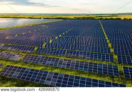 Aerial View Of Large Sustainable Electrical Power Plant With Many Rows Of Solar Photovoltaic Panels